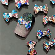 10ks 3D barevné luk slitiny šperky třpytky křišťálově nail art dekorace tipy