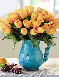"8.75""Orange Color Tulip Arrangement With Blue Ceramic Vase"