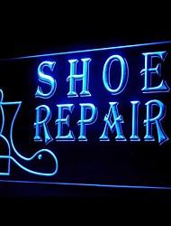 la publicidad de reparación de calzado llevó la muestra de la luz
