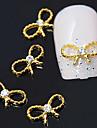 10st gyllene bowknot 3d legering klar rhinestone nail art dekoration
